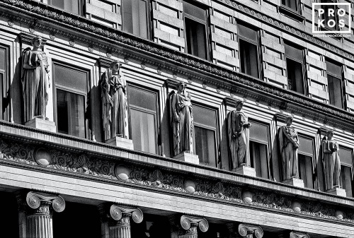The neoclassical facade of 100 Broadway in New York City's Financial District in black and white