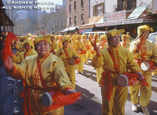 Chinese women beating drums during the Lunar New Year festival in Chinatown, New York