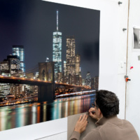 Photographer Andrew Prokos signing a large scale 120 inch limited edition print