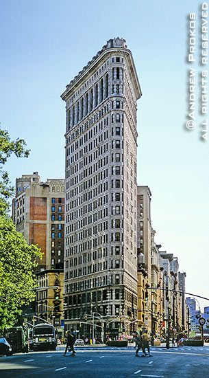 A view of New York City's Flatiron Building from Fifth Avenue during the day