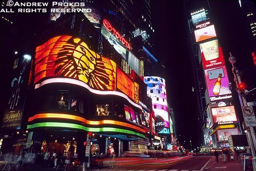 The electronic 'jumbotron' signs along Broadway in Times Square at night, New York City