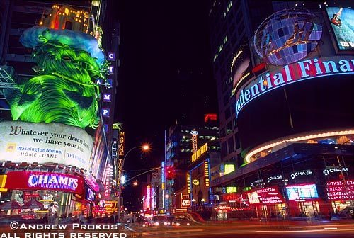 A view of the corner of 42nd Street and Broadway in Times Square at night