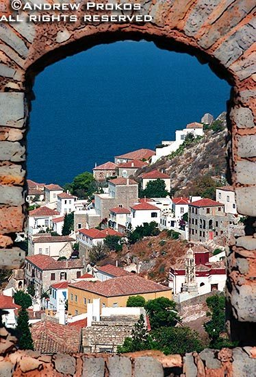 View of Hydra Town through a stone window, Hydra, Greece