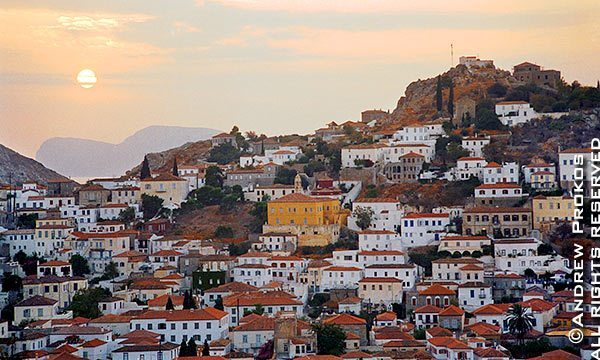 A view of the old stone houses of Hydra Town at sunset, Hydra, Greece