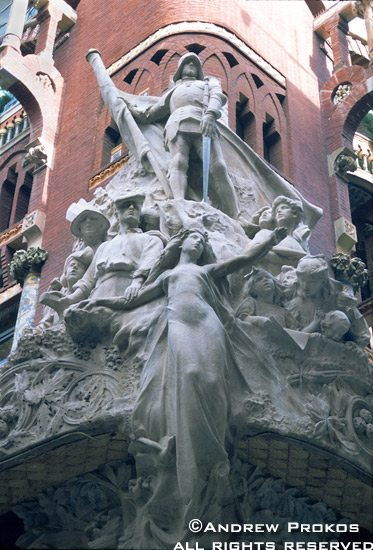 An ornate sculpture group on the facade of the Palau de la Musica Catalana in Barcelona, Spain