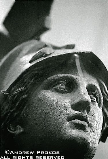 A bronze statue of the goddess Athena in Piraeus Museum, Athens in black and white