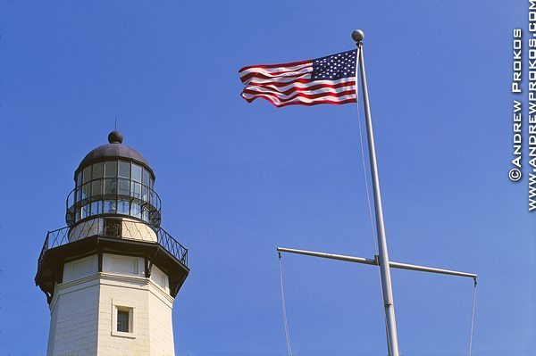 A view of Montauk Point Lighthouse with American Flag, Long Island, New York
