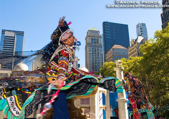 An Indian folk dancer in traditional costume takes a whirl in Bryant Park, New York City