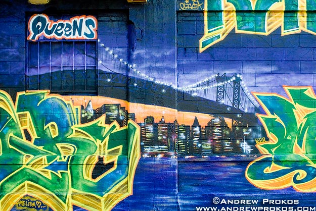 A painted street mural of the Queensskyline at night,New York City