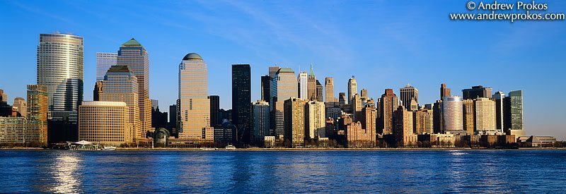 A panoramic skyline of Lower Manhattan during the day as seen from New Jersey