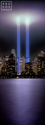 A vertical panoramic view of the Towers of Light memorial in Lower Manhattan, New York City.