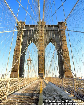 A view of the Brooklyn Bridge's tower and suspension cables in Winter