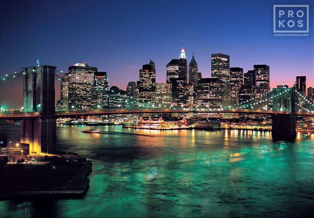 A photo of the Lower Manhattan skyline and the Brooklyn Bridge at dusk, New York City