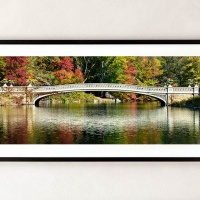"""A framed fine art print of """"Panoramic View of Bow Bridge in Autumn, Central Park"""" by photographer Andrew Prokos."""