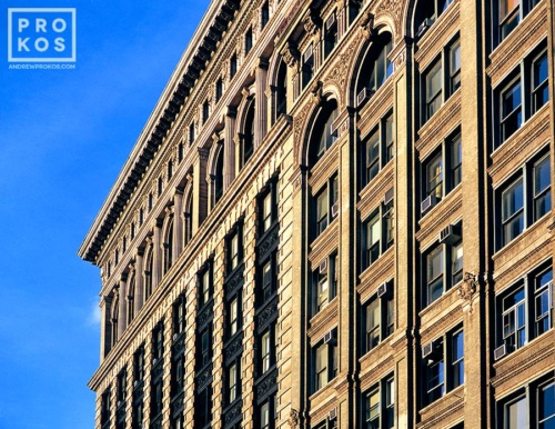 The facades of buildings along Broadway in Downtown Manhattan in color, New York City