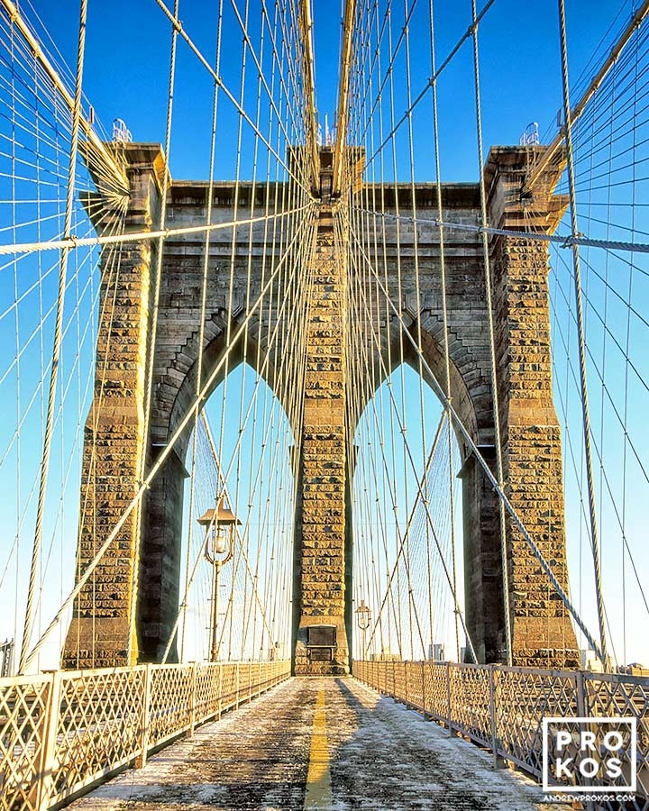 A view of the Brooklyn Bridge's tower and suspension cables in color.