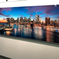 "An 80 inch limited edition HD metal print of ""Brooklyn Bridge and Lower Manhattan Skyline at Dusk"" by photographer Andrew Prokos"