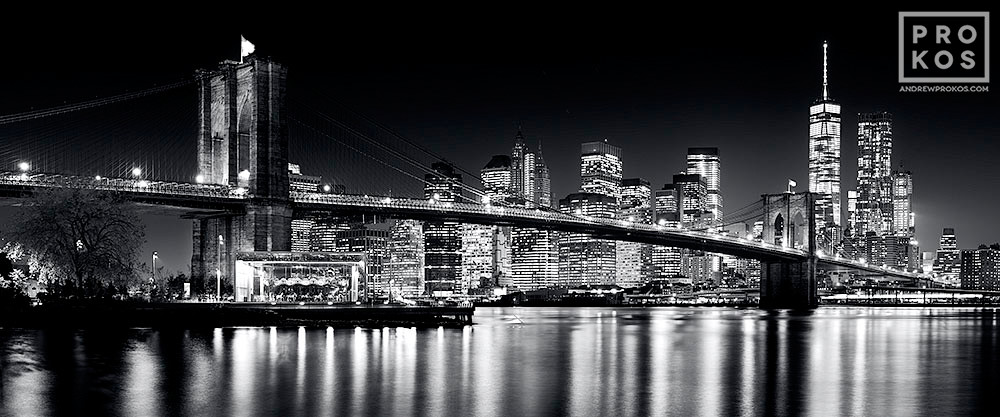 A panoramic skyline of the Brooklyn Bridge and Lower Manhattan at Night, New York City