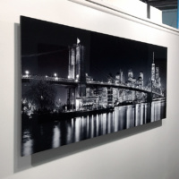 "A 60 inch limited edition HD metal print of ""Panoramic Skyline of Brooklyn Bridge and Lower Manhattan at Night"" by photographer Andrew Prokos"
