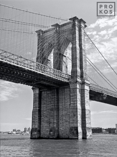 A view of the Manhattan side tower of the Brooklyn Bridge in black and white, New York City