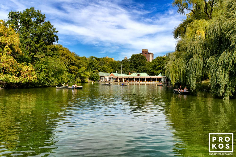 A view of the lake and boathouse in Central Park, New York City