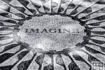 A black and white photo of the Imagine mosaic in Central Park's Strawberry Fields, dedicated to the memory of John Lennon. New York City