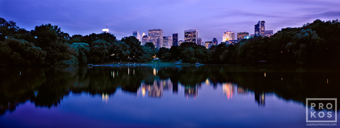 A panoramic view of Midtown Manhattan and the Lake at dusk, Central Park