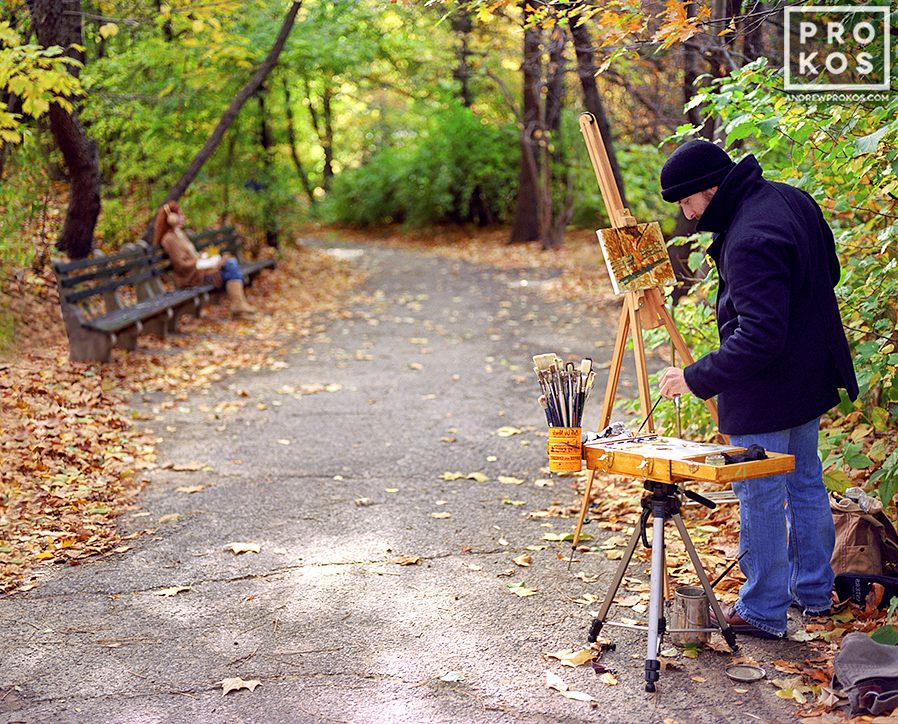 A painter with his model in Central Park, New York City