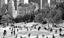 Wintertime ice skaters in Central Park, New York City
