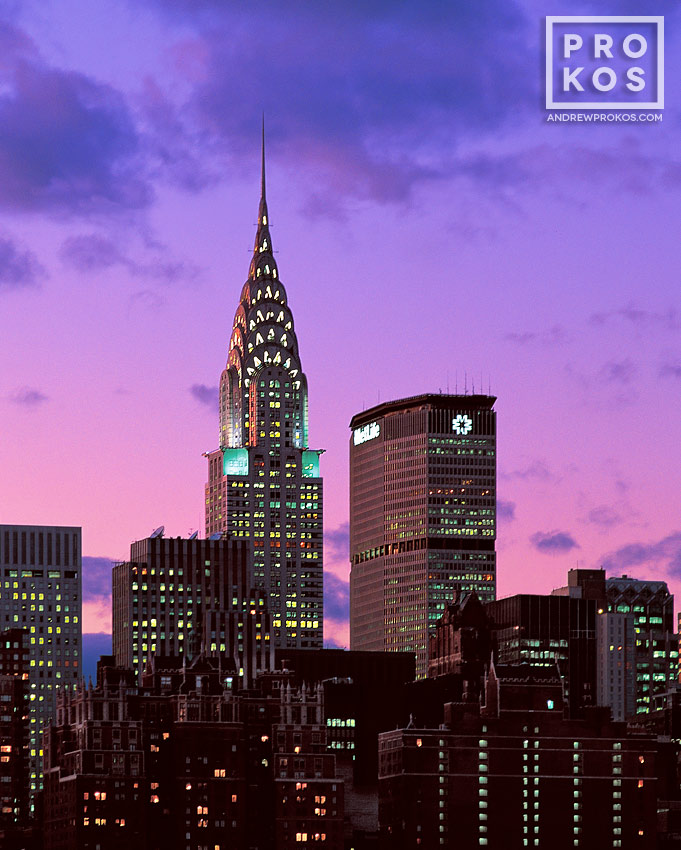 A view of the Chrysler Building and met Life Building set against a vivid sky at twilight, New York City