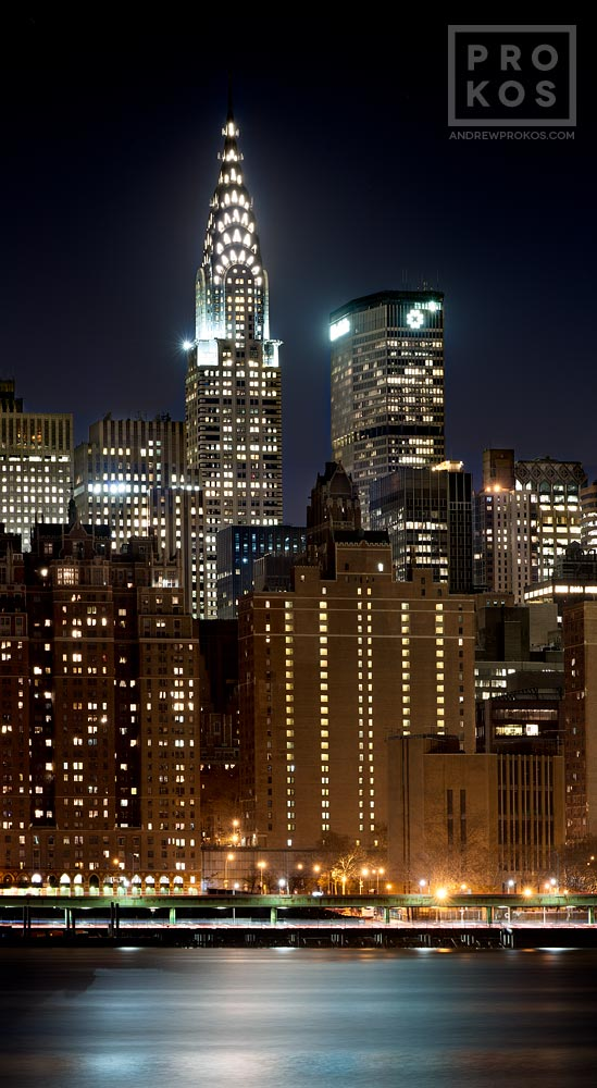 A panoramic view of Midtown Manhattan and the Chrysler Building at night.