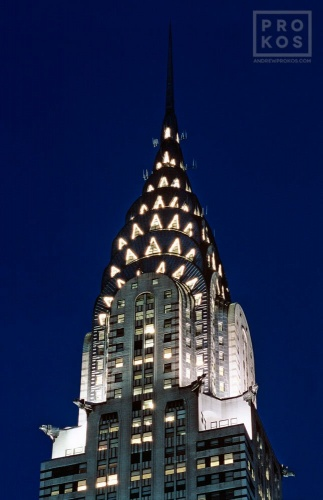 A fine art photo of the illuminated spire of the Chrysler Building at night