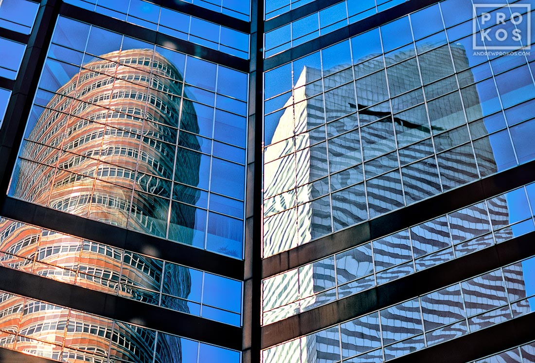 Citicorp Tower and the Lipstick Building reflected on the glass facade of an East Midtown skyscraper, New York City