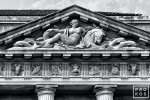 A detail of the pediment from the US Department of Commerce building in black and white, Washington DC
