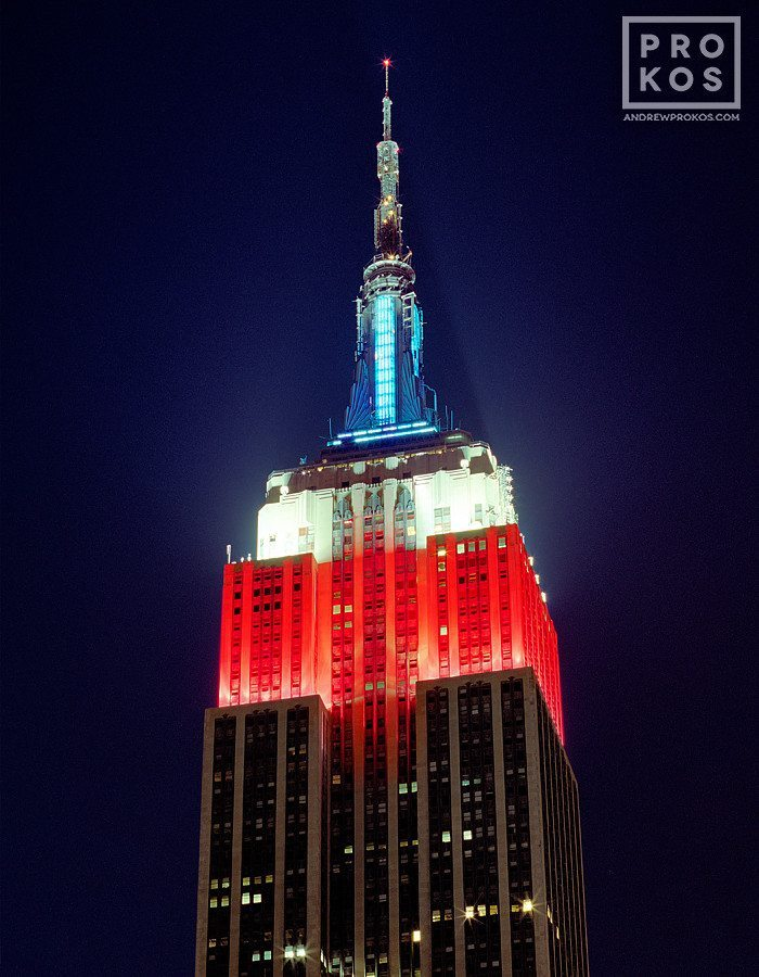 The Empire State Building at night lit in red, white, and blue, New York City