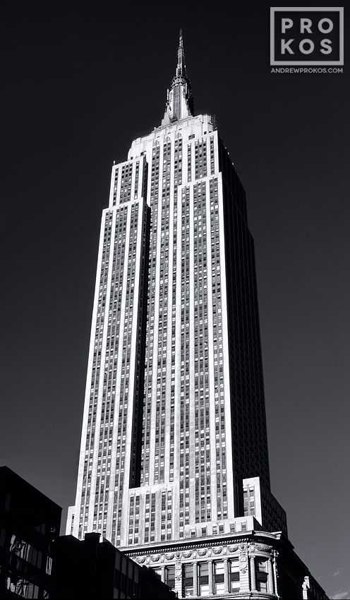 A vertical panorama of the Empire State Building in black and white, New York City