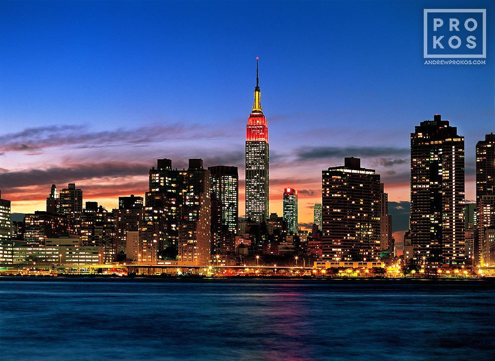 The skyline of New York City and the Empire State Building at dusk