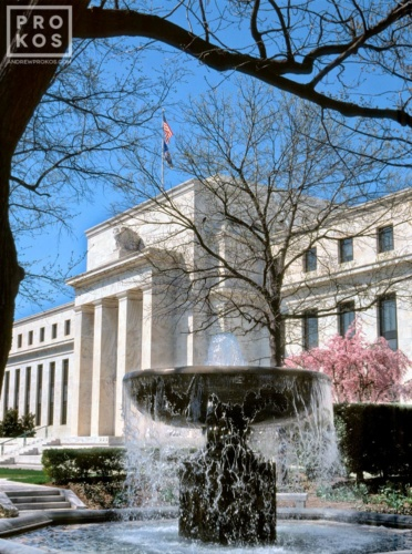 A view of the United States Federal Reserve in Washington DC, with fountain.