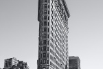 A view of the Flatiron Building from Broadway in black and white, New York City