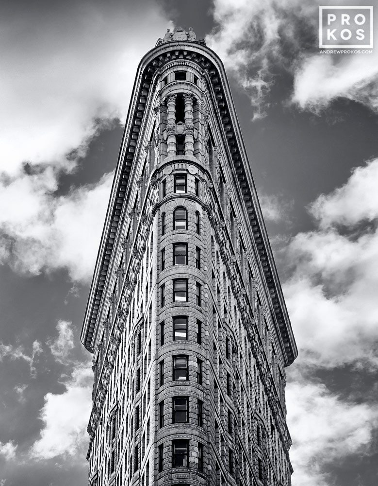 A black and white view of the Flatiron Building set against the sky, New York City