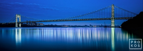 A panoramic photo of the entire span of the George Washington Bridge at night, New York City