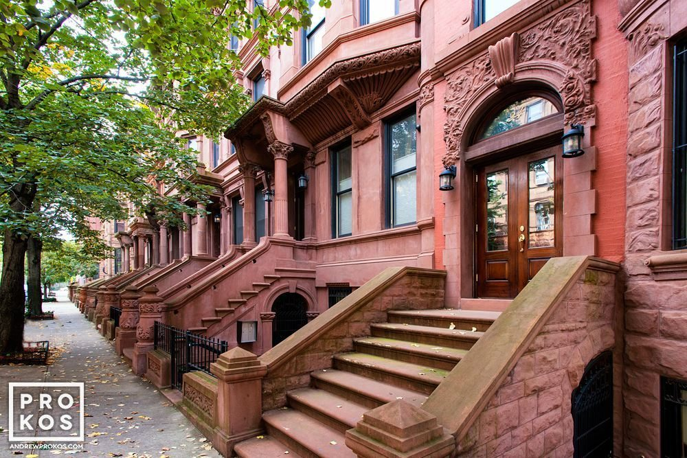 A row of classic brownstones in the Mt. Morris section of Harlem, New York City