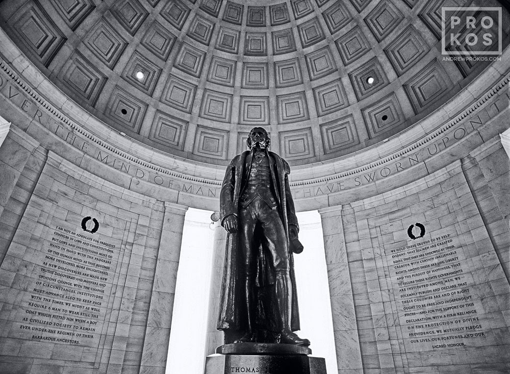 A black and white view of the interior of the Jefferson Memorial with bronze statue of Thomas Jefferson, Washington DC