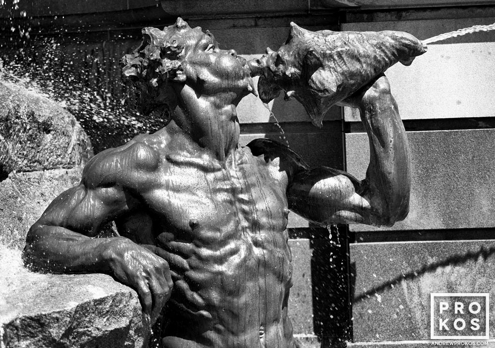 A detail from the Neptune Fountain at the Library of Congress in black and white, Washington D.C.