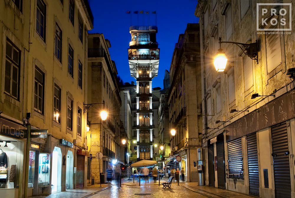 A view of the Santa Justa neighborhood of Lisbon, Portugal at night, including the neighborhood's famous elevator