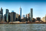 A panoramic skyline of Lower Manhattan and the Brooklyn Bridge as seen from Brooklyn, New York during the day