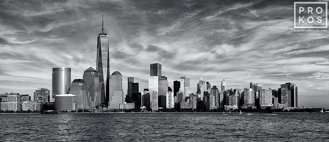 A panoramic skyline of Lower Manhattan, Hudson River, and the World Trade Center in black and white as seen from New Jersey