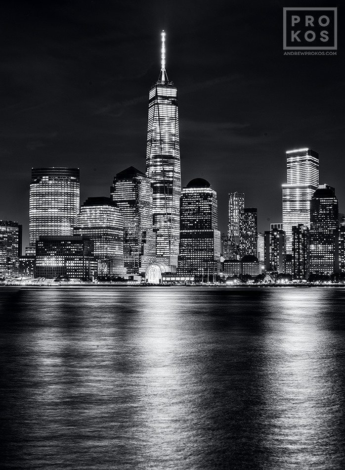 A black and white view of Lower Manhattan, Hudson River, and the World Trade Center at night, New York City