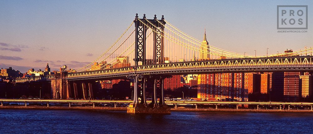 A view of the Manhattan Bridge and East River at sunset, New York City