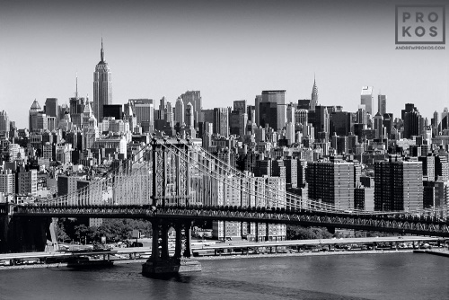 A skyline of New York City and the Manhattan Bridge in black and white